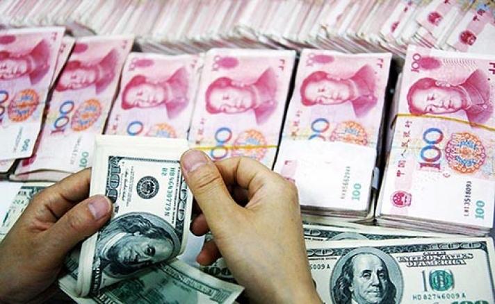 Юанийн ам.доллартай харьцах ханшийг буурууллаа