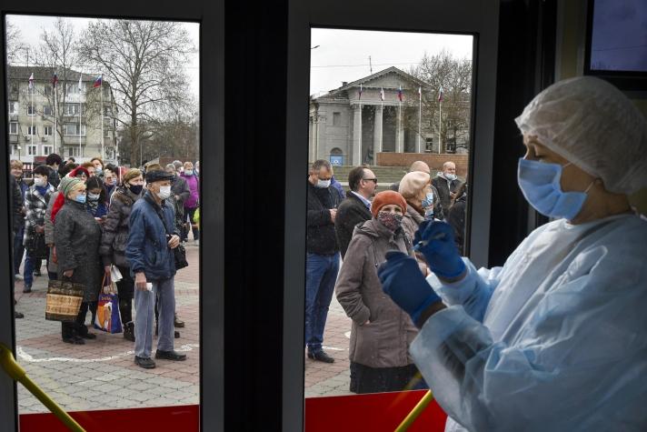 ОХУ: Бүх хүн амаа вакцинжуулсан цагт цар тахал зогсоно