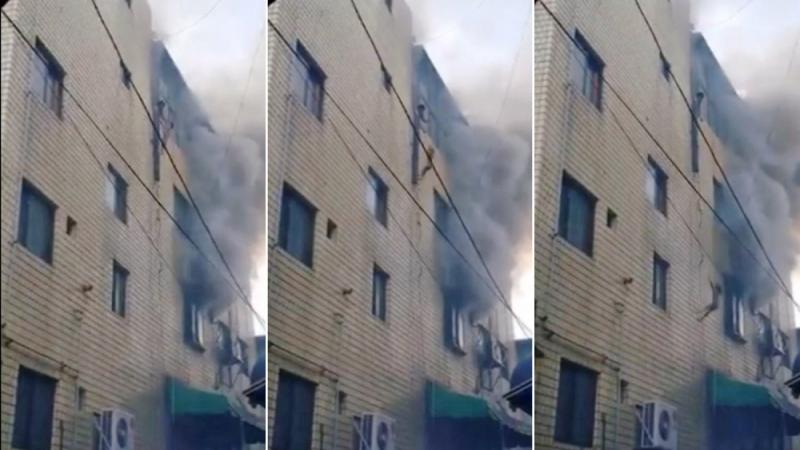 Дөрвөн давхарын цонхоор шидэж гурван хүүхдээ галаас аварчээ
