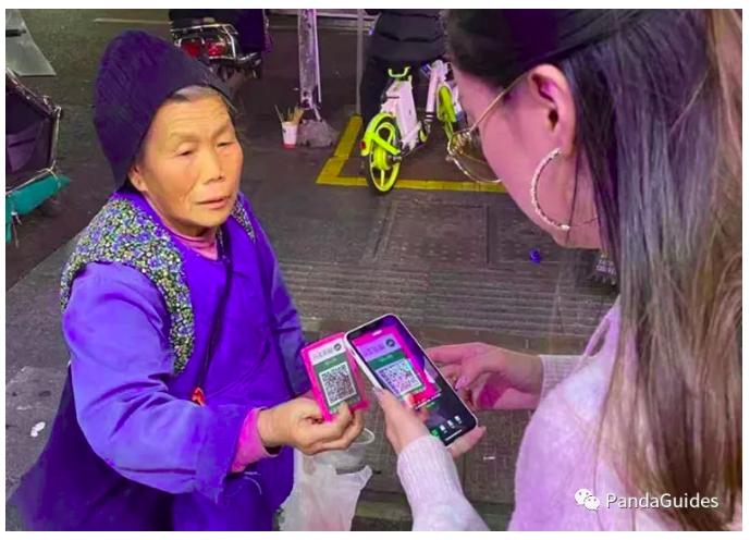 Хятадад гуйлгачид WeChat Pay-ээр гуйлга авч байна